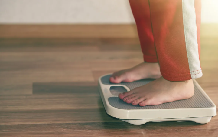 the person on the scales